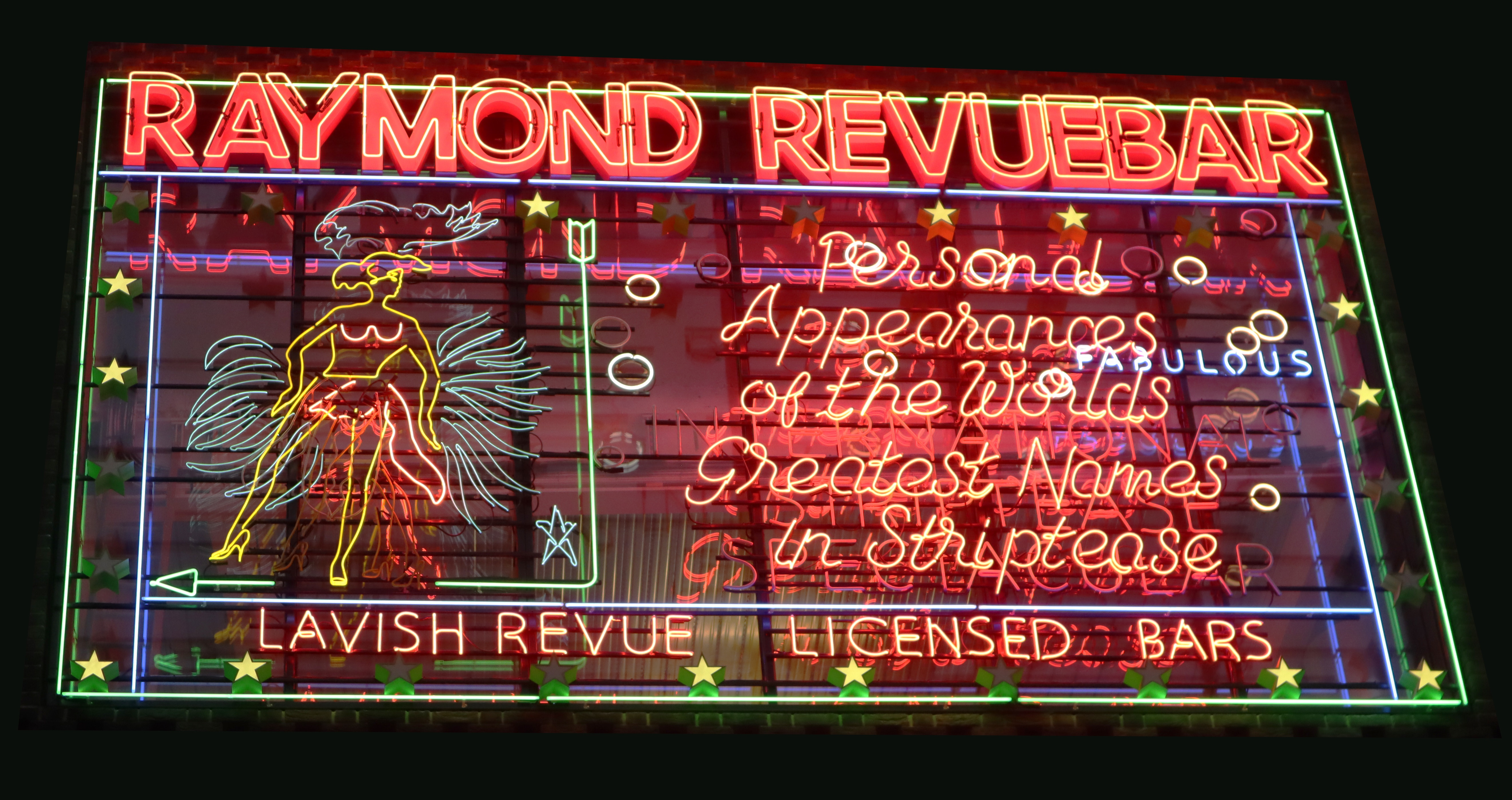 Iconic neon sign in Soho, London: Raymon Revuebar